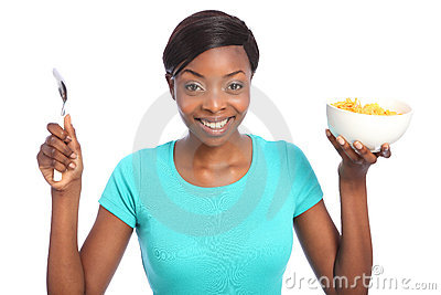 Beautiful happy black woman with breakfast cereal