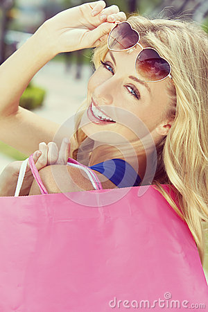 Free Beautiful Happy Blond Woman With Shopping Bags Stock Image - 65740561