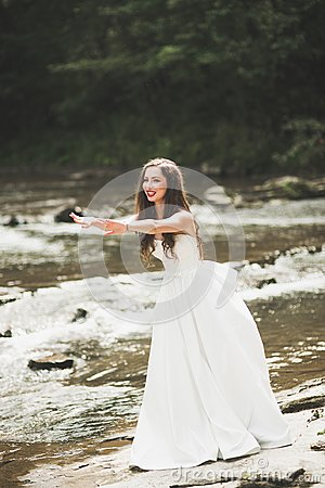 Free Beautiful Happy Bride Outdoors In A Forest With Rocks. Wedding Perfect Day Royalty Free Stock Photography - 109373337