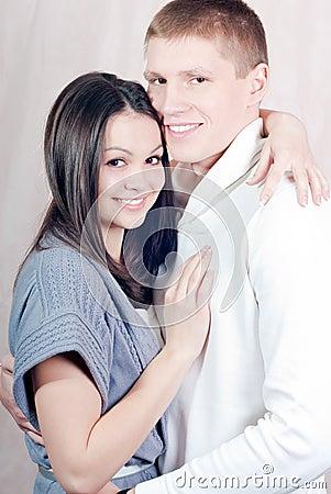 Beautiful happy couple gently hugging
