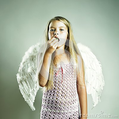 Beautiful happy girl with angel wings