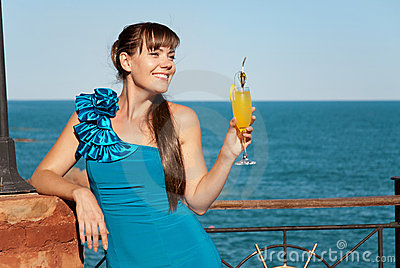 Beautiful happy girl with a drink