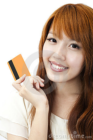 Beautiful happy girl  holding  a credit card