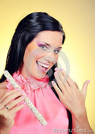 Beautiful happy girl with a sweet lollipop