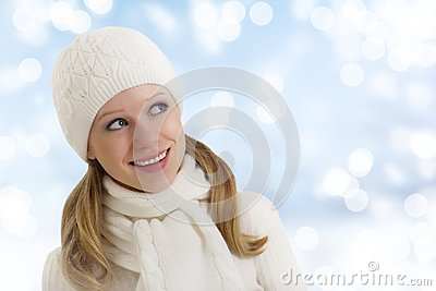 Beautiful happy girl in winter hat and scarf