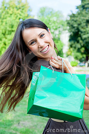 Beautiful happy woman with bag