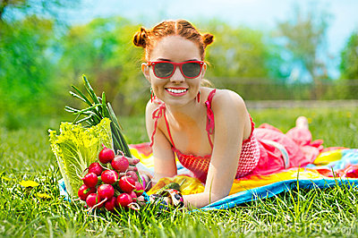 Beautiful happy woman with colourful vegetables