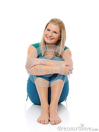 Beautiful happy woman doing fitness pilates
