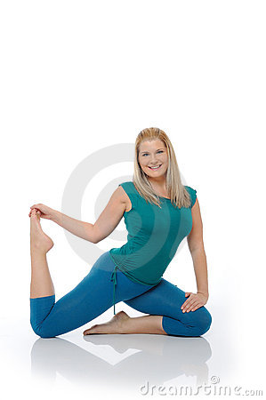 Beautiful happy woman doing pilates pose