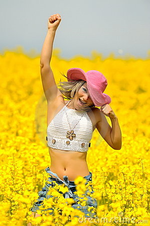 Beautiful happy woman on rape field