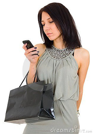 Beautiful happy woman with shopping bag