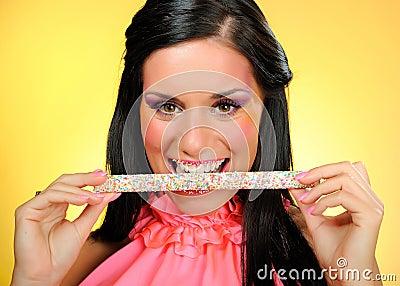 Beautiful happy woman with a sweet lollipop