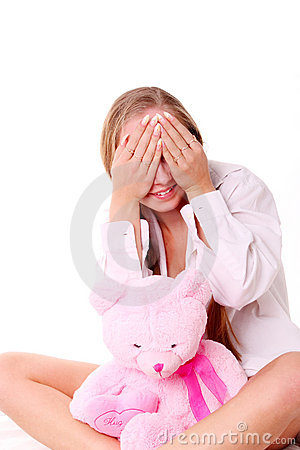 Beautiful, happy young girl with soft toy.