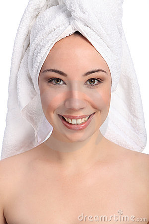 Beautiful happy young woman bath towel on her head