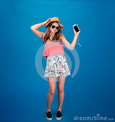 Free Beautiful Happy Young Woman Listening To Music And Dancing Stock Image - 67193281