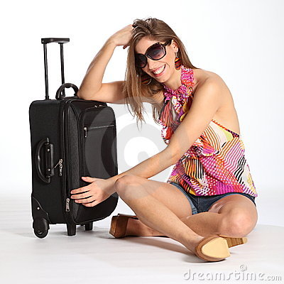 Beautiful happy young woman sitting with suitcase