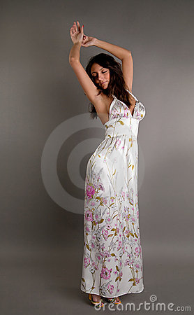 Beautiful harmonious brunette in a dress