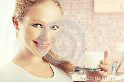 Beautiful healthy girl with a glass of milk