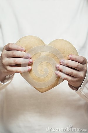 Free Beautiful Heart Made Of Wood In Children Hands Royalty Free Stock Images - 103796429