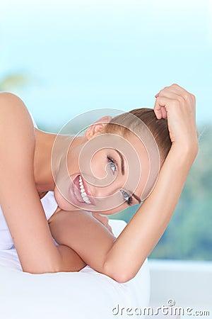 Beautiful high-spirited woman laughing
