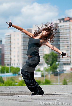 Beautiful hip-hop woman over urban landscape