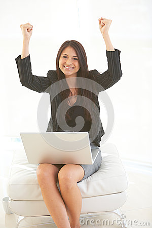 Beautiful hispanic business female with laptop excited