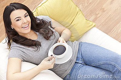 Beautiful Hispanic Woman Drinking Tea or Coffee