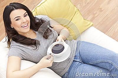 Beautiful Hispanic Woman Drinking Tea or Coffee