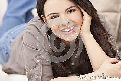 Beautiful Hispanic Woman Laying on Sofa Relaxing