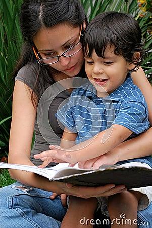 Free Beautiful Hispanic Women Reads To A Little Boy Stock Image - 9188171