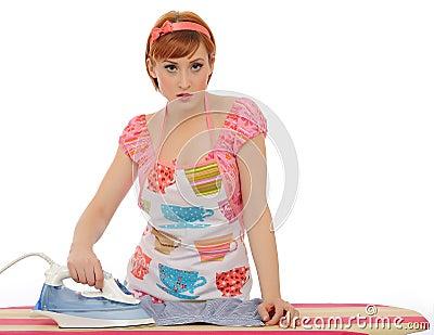 Beautiful house woman ironing mens shirt