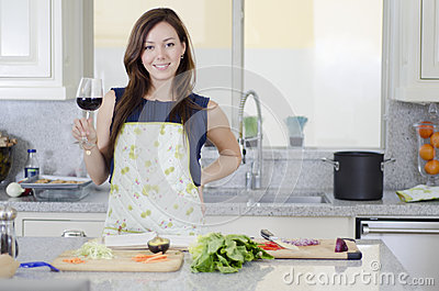 Beautiful housewife cooking dinner