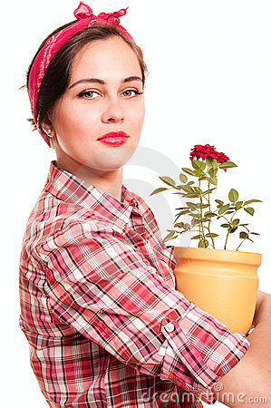 Beautiful housewife with flower pot