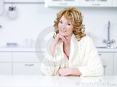 Beautiful housewife in the kitchen