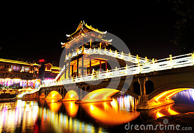 Beautiful illuminated bridge at fenghuang ancient