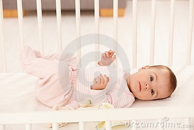 Beautiful infant in crib
