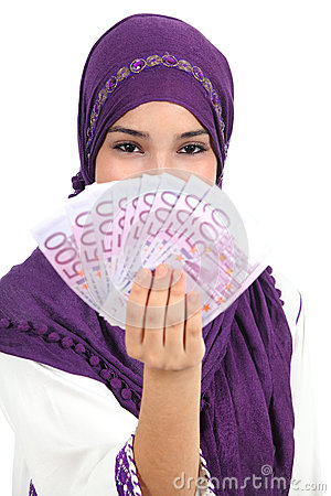 Beautiful islamic woman wearing a hijab showing a lot of banknotes