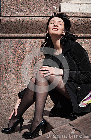 Beautiful italian woman sitting on steps