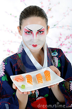 Beautiful japan geisha woman with sushi