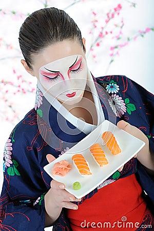 Beautiful japan geisha woman with sushi