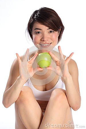Beautiful Japanese girl holding green apple fruit