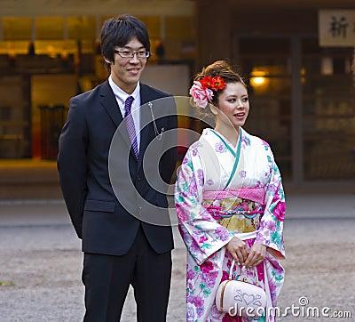 Beautiful Japanese girl kimono man suit Editorial Photo