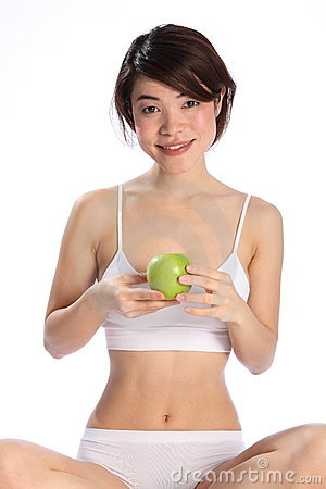 Beautiful Japanese woman sitting with an apple