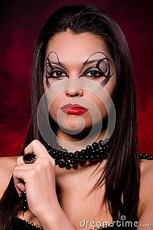 Beautiful lady with art makeup