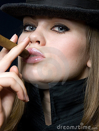 Beautiful lady in black and a cigar