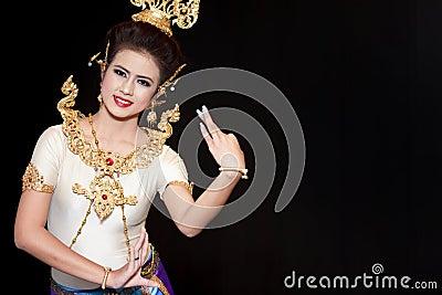 Beautiful lady dancing for original Thai dance Editorial Stock Image