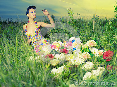 Beautiful lady in dress of flowers