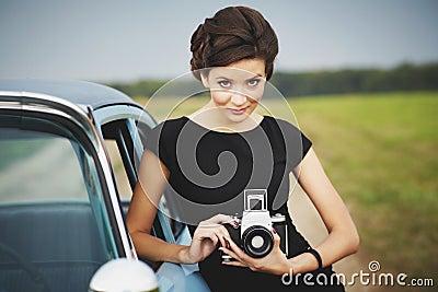 Beautiful lady with a retro camera