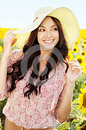 Beautiful lady in sunflower field