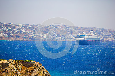 Beautiful landscape with sea view. Cruise liner at the sea near the islands. Mykonos island, Greece Stock Photo